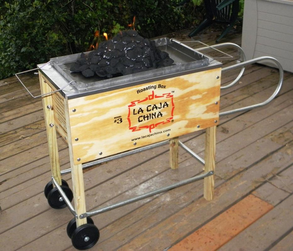 La Caja China roasting box model #3 on a wooden pation outside.